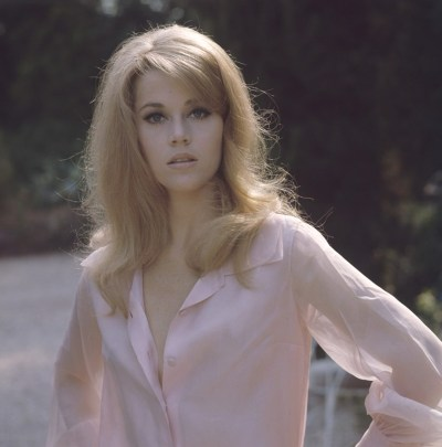 Jane Fonda outside in a pink blouse | 24 Femmes Per Second