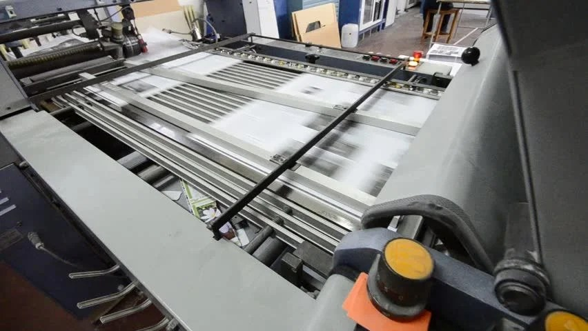 Printing House Free Video Clips    146 Free Downloads      folding machine HD CRANE SHOOT folds printed offset sheet as part of  newspaper brochure in print