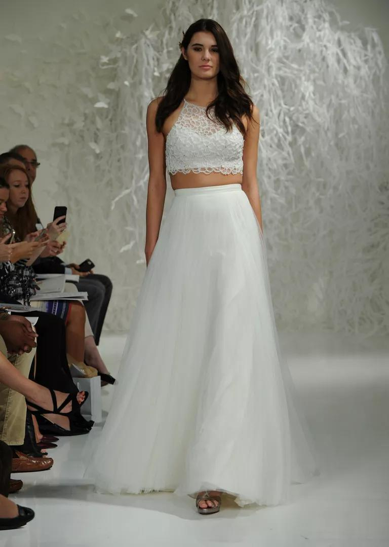 watters wedding dresses bridal fashion week fall lace top wedding dress Watters Fall crop top and skirt wedding dress with illusion neckline lace top and layered