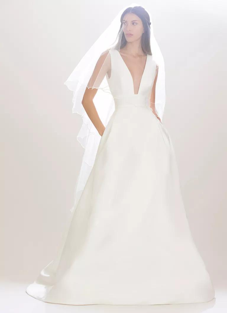 carolina herrera wedding dresses bridal fashion week fall plunging neckline wedding dress Carolina Herrera Fall satin a line sleeveless wedding dress with plunging neckline