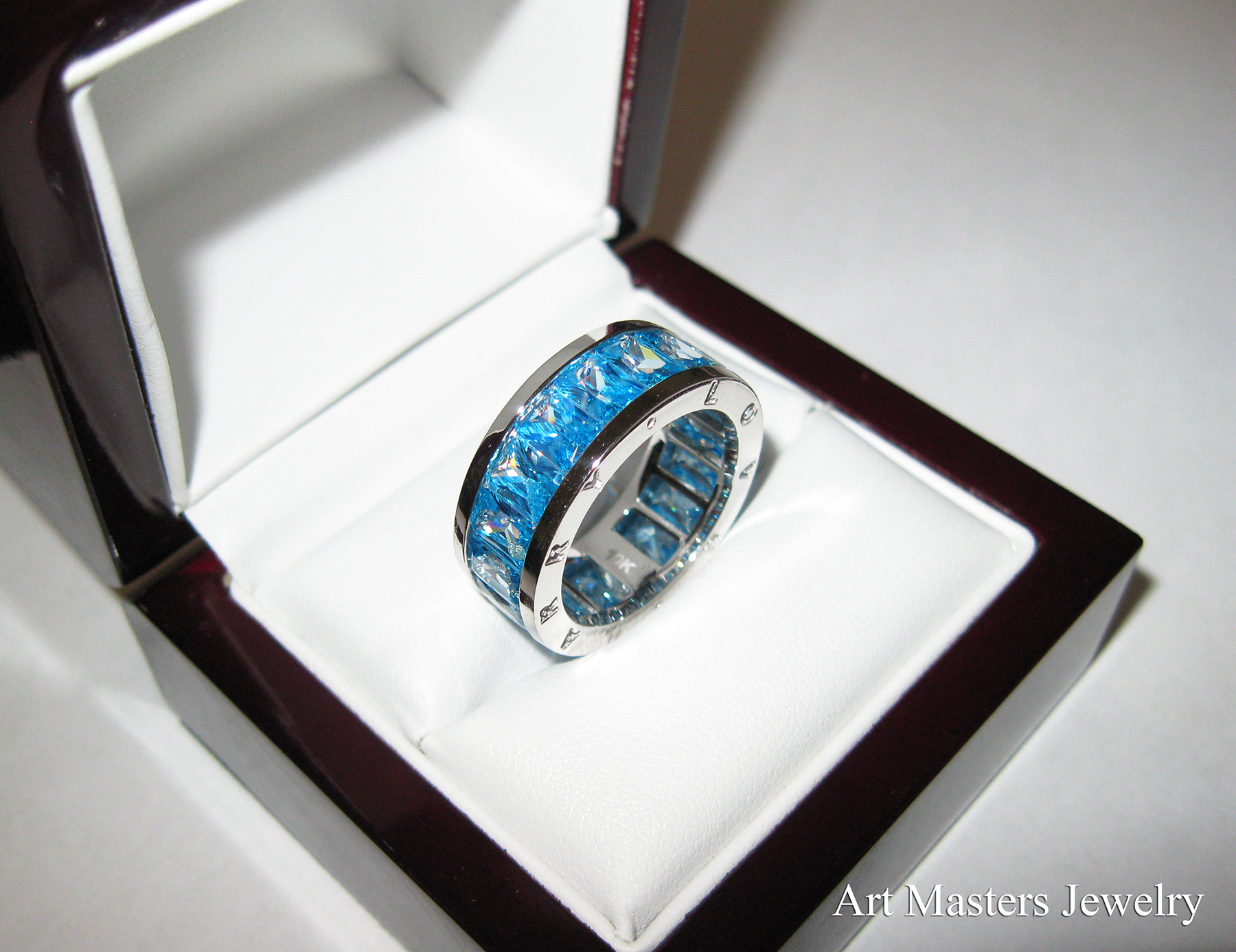 mens modern 10k white gold blue topaz channel cluster infinity wedding band r 10wgbt infinity wedding band Mens Modern 10K White Gold Blue Topaz Channel Cluster Infinity Wedding Band R 10WGBT