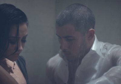 "Shay Mitchell & Nick Jonas Get Close For New Music Video, ""Under You"""
