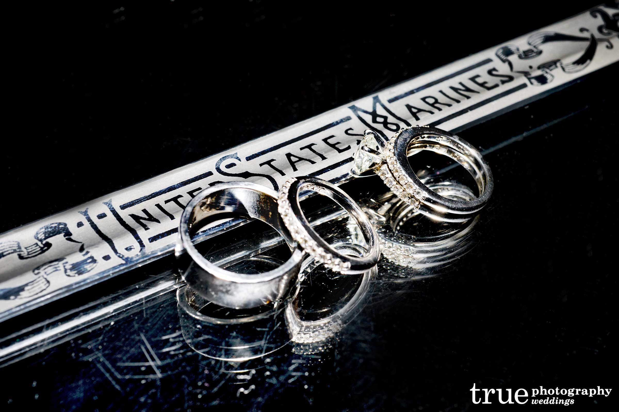 san diego military wedding photographer marine wedding rings Military wedding in San Diego photo of US Marine sword with wedding rings