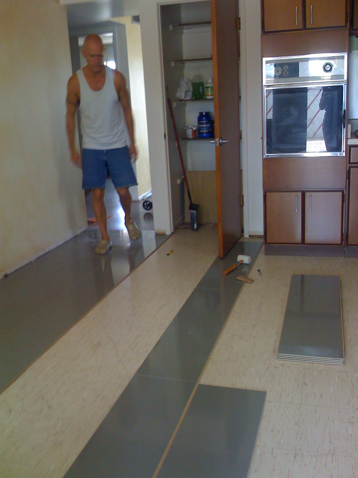 beautiful new flooring in the kitchen laminate flooring for kitchen It s a simple click in place floor no adhesive no underlayment required It took us about four hours to install it in the sf kitchen