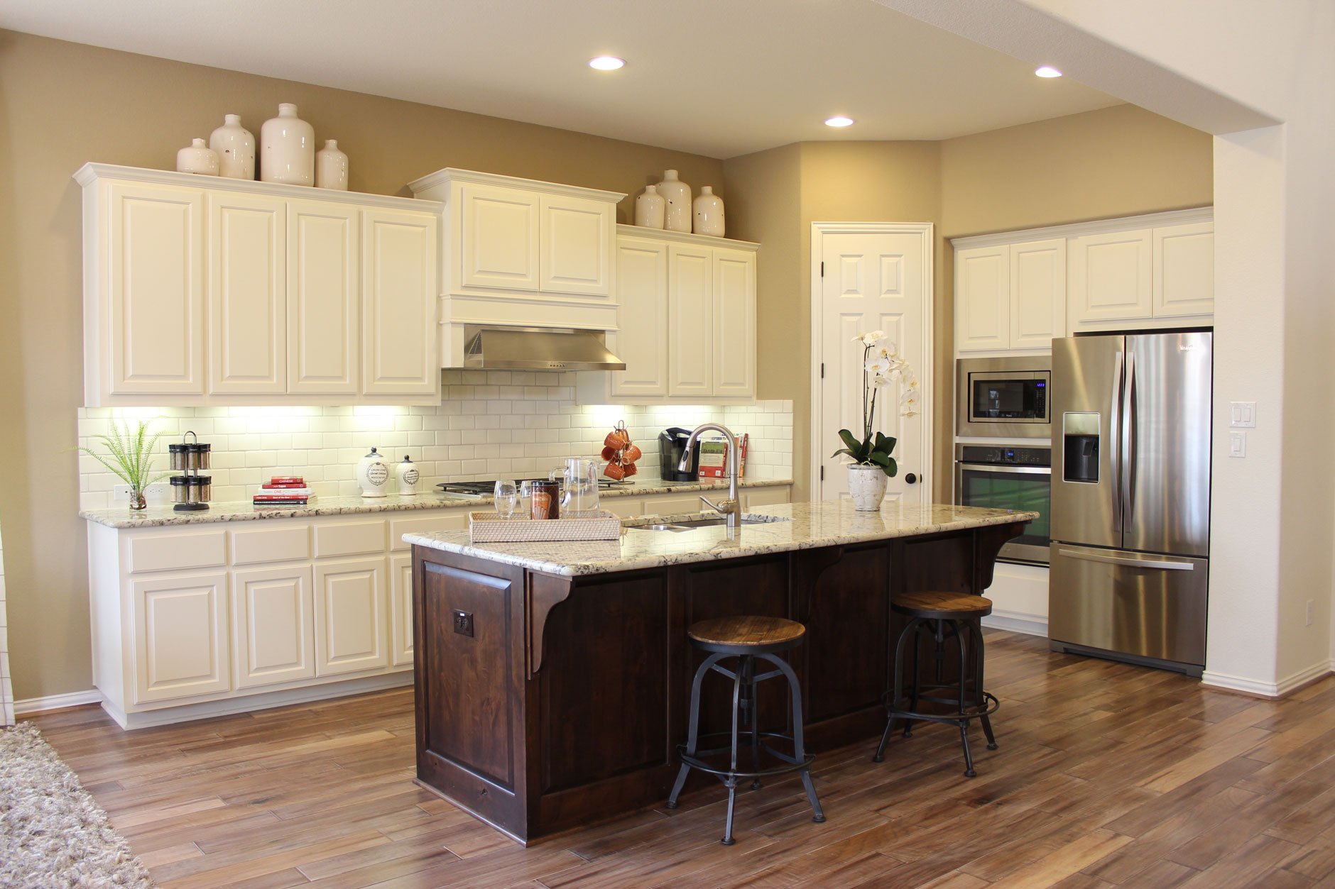 choose flooring compliments cabinet color kitchen floor cabinets Burrows Cabinets kitchen in knotty alder with Verona finish and appliance end panels
