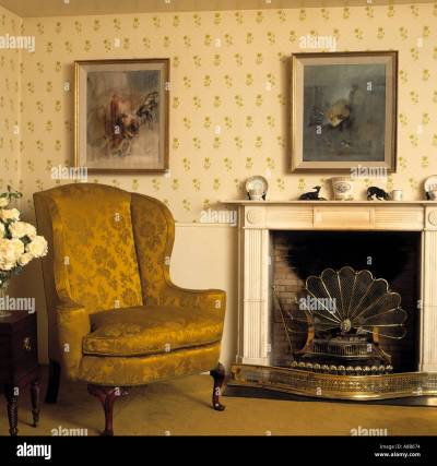 Gold brocade armchair beside fireplace with fan-shaped fireguard in Stock Photo, Royalty Free ...