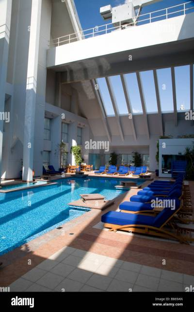 INDOOR / OUTDOOR ROOF SWIMMING POOL DUSIT HOTEL UAE DUBAI Stock Photo, Royalty Free Image ...