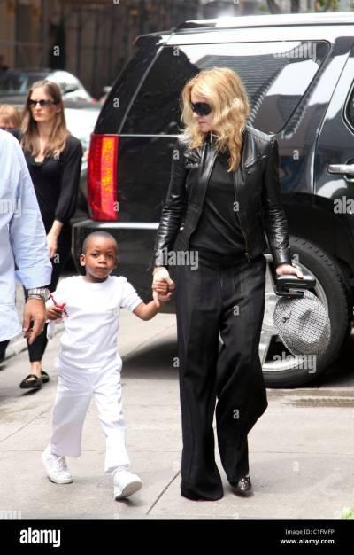 Madonna and son David Banda arriving at the Kabbalah Center New York Stock Photo, Royalty Free ...