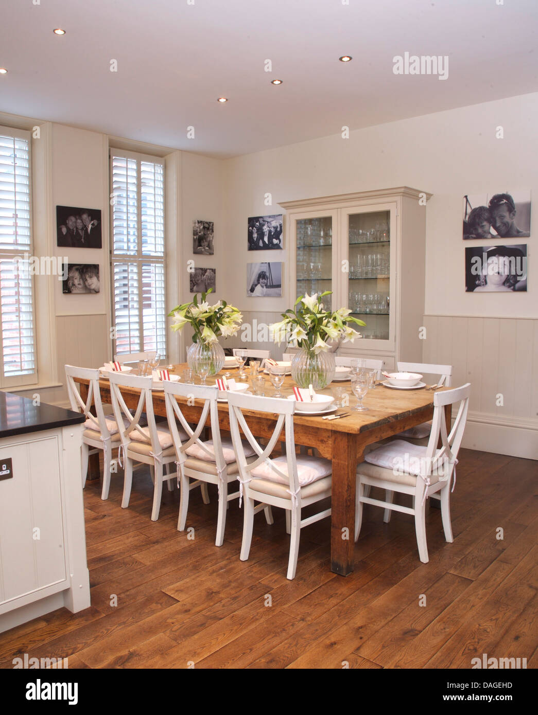 white chairs at simple wood table in modern white kitchen dining room DAGEHD