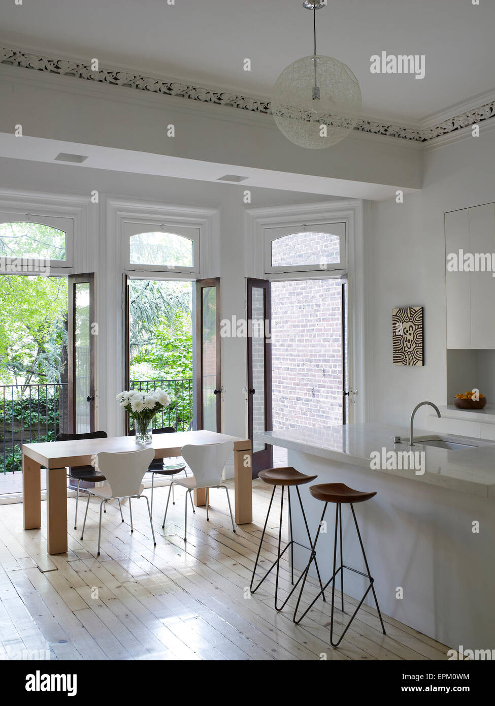 breakfast bar stools and small dining table in white kitchen with EPM0WM