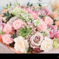 Close Up Beautiful Luxury Bouquet of Mixed Flowers on Wooden Table