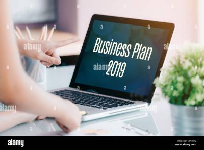 Business people meeting in front of laptop computer screen ...