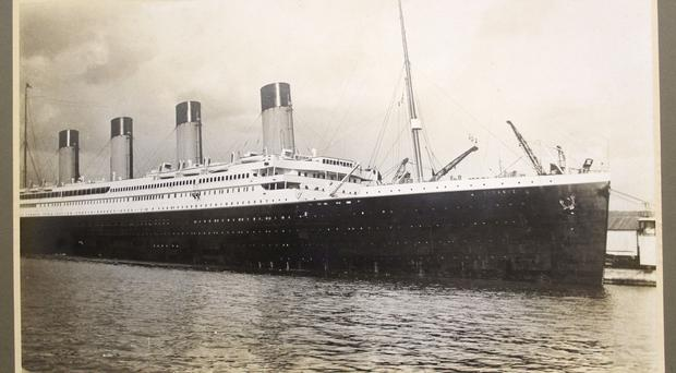 Titanic menu for first meal sells for     100k at auction     A photograph of the Titanic believed to have been taken the day before she  left on