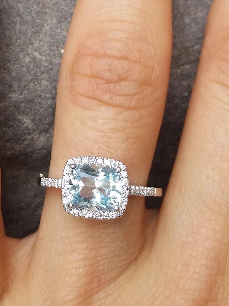 aquamarine diamond cushion cut cocktail ring aquamarine wedding rings Aquamarine Diamond Halo Ring on hand