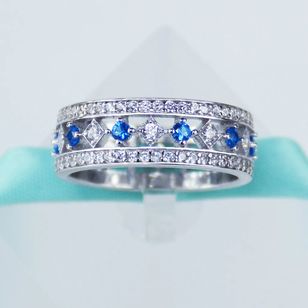 does anyone else have engagement and wedding rings that dont go together blue topaz wedding band image