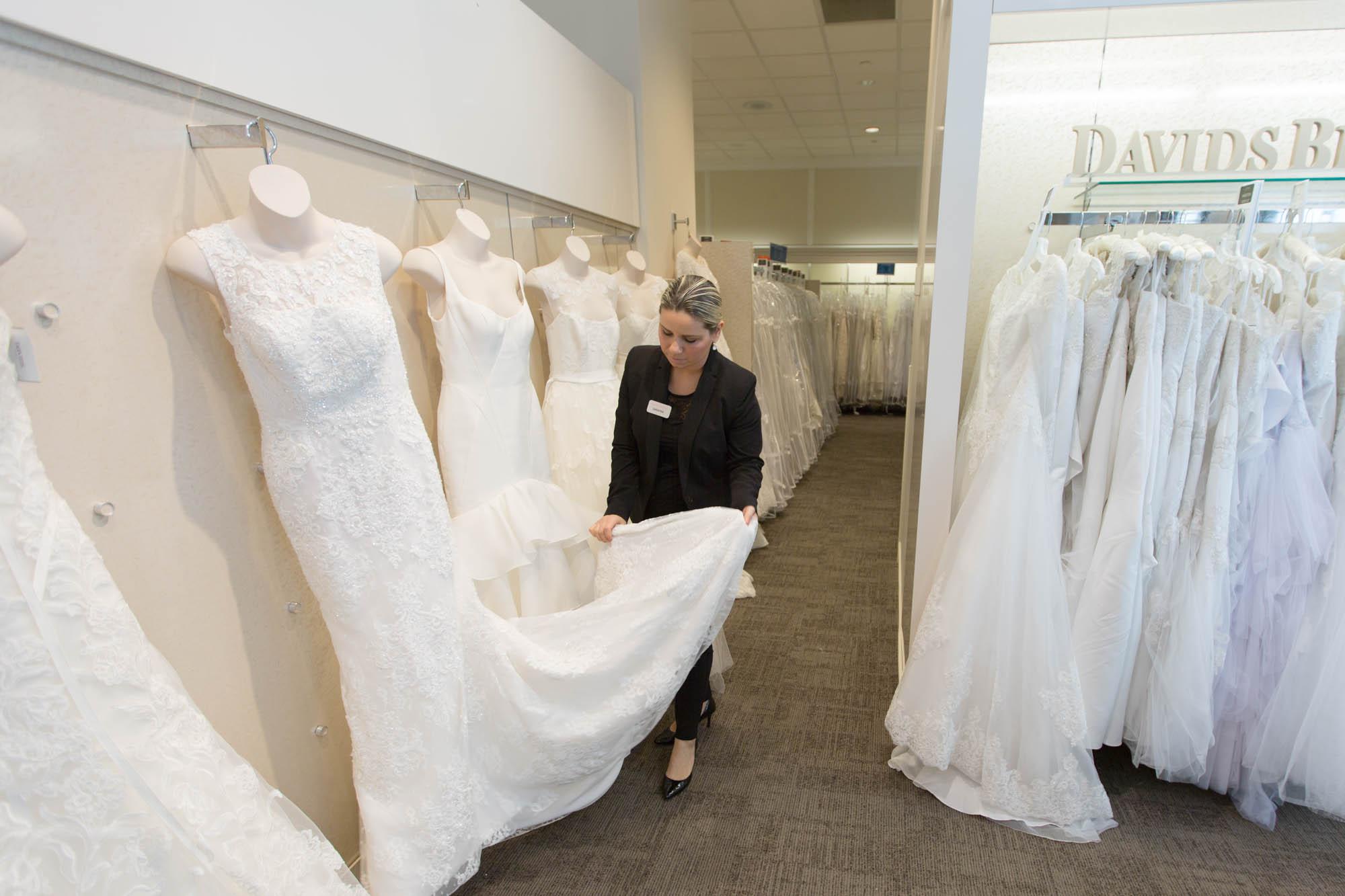 davids bridal wedding dress wedding dress garment bag A David s Bridal dress consultant tends to a display Photo by Alex Ulreich for Racked