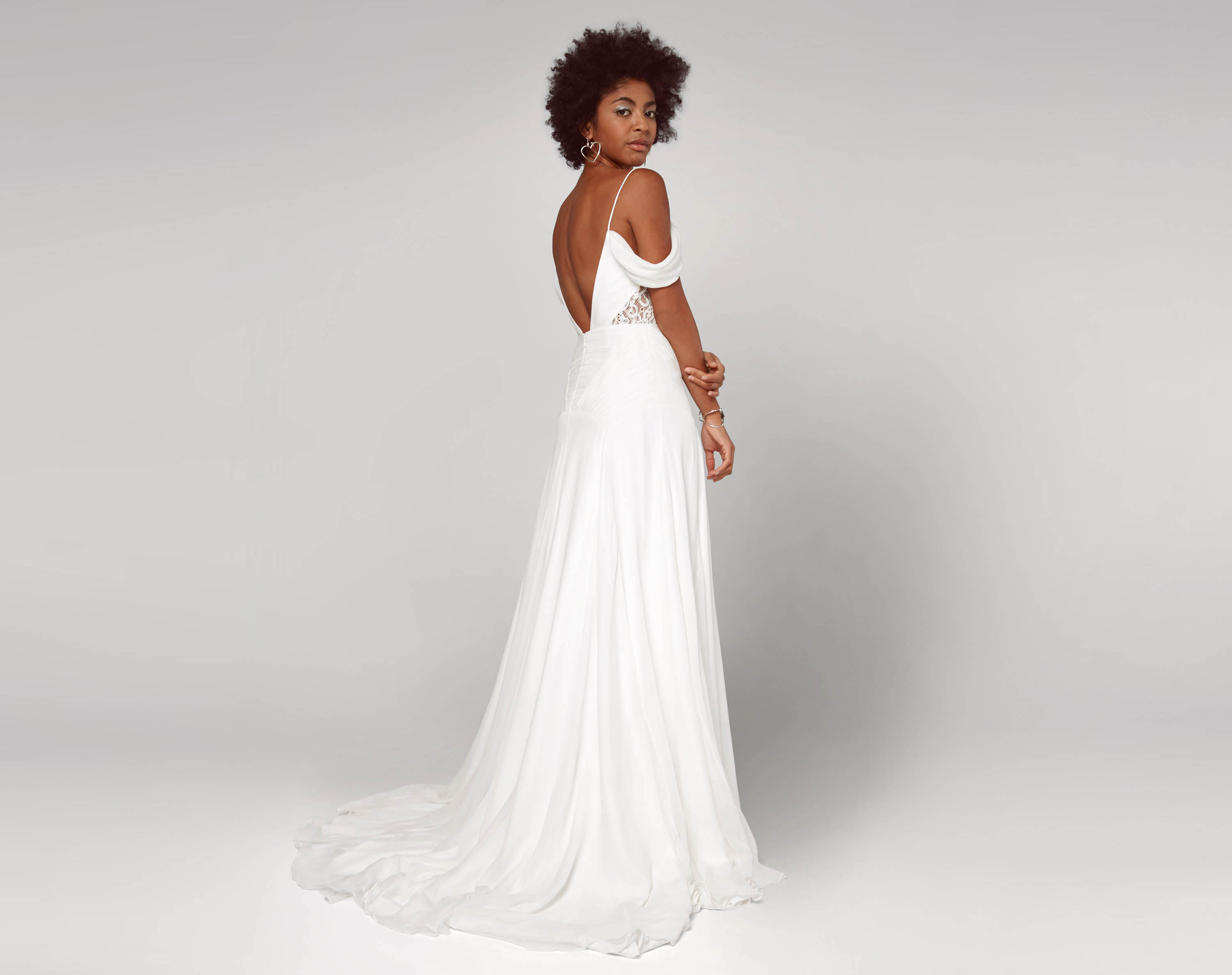cheap wedding dresses fame partners bridal gorgeous wedding dresses A model wearing a white wedding gown with an open back thin straps and