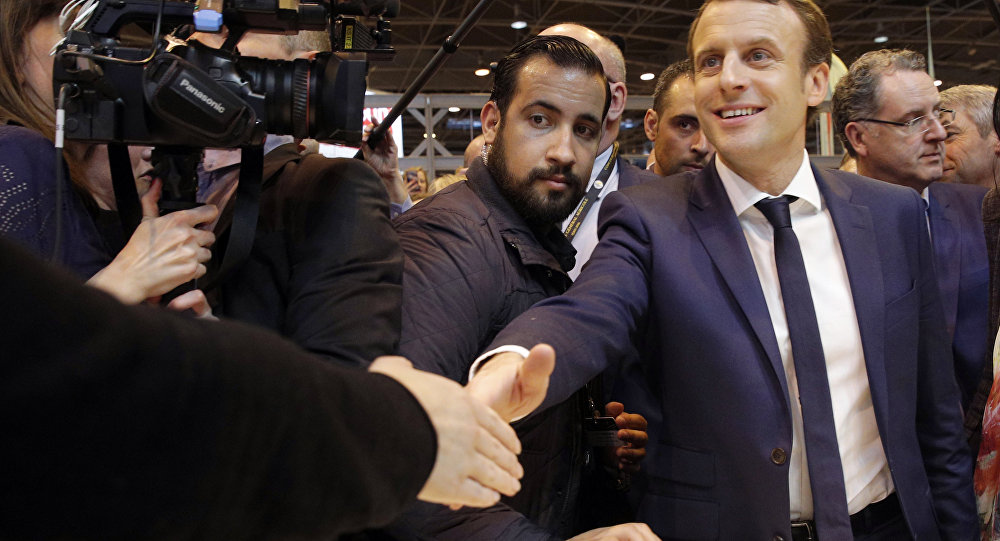 Macron Slammed for  Giving Finger  With  Not My Lover  Response to     Emmanuel Macron  center  flanked by his bodyguard  Alexandre Benalla  left   visits