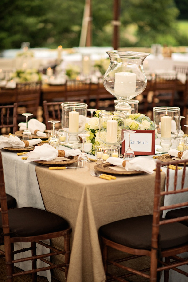 tablecloths for wedding Tented wedding reception with table covered in tan tablecloth and white fabric candles