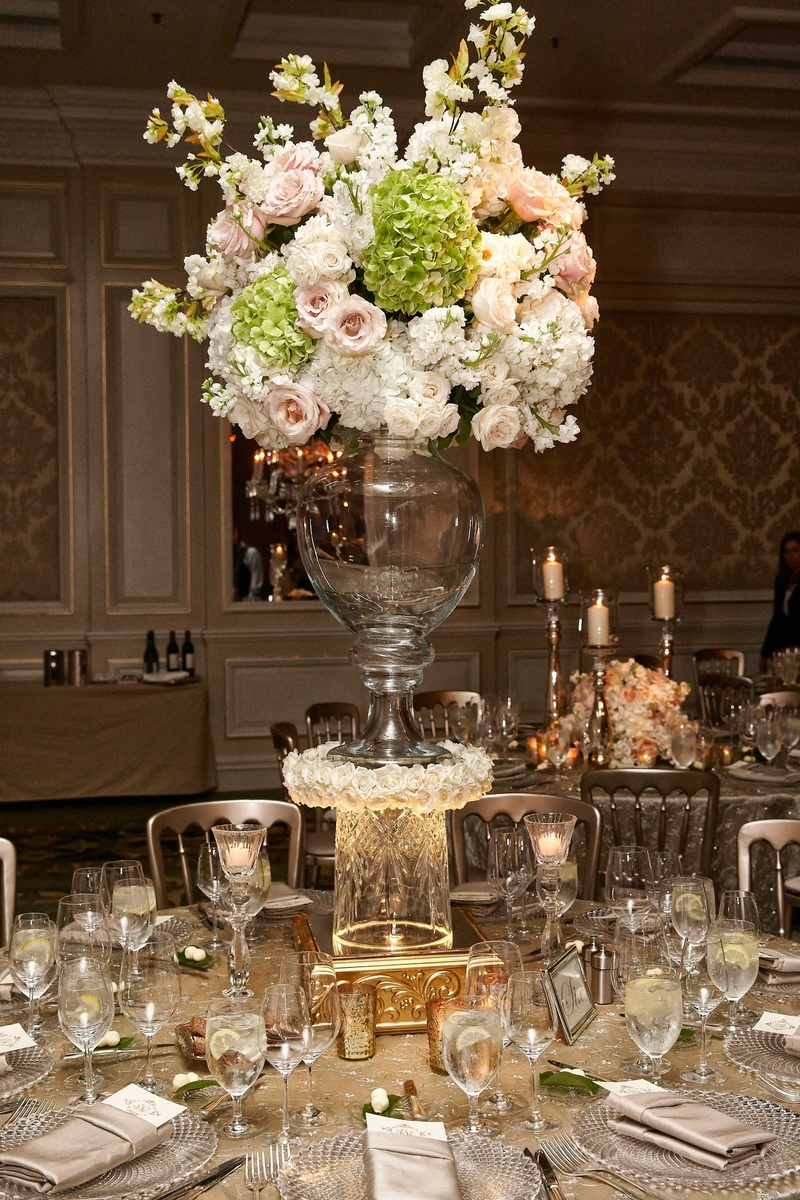 tall wedding centerpiece with pink roses tall wedding centerpieces Wedding arrangement of pink rose white hydrangea on top of glass vase