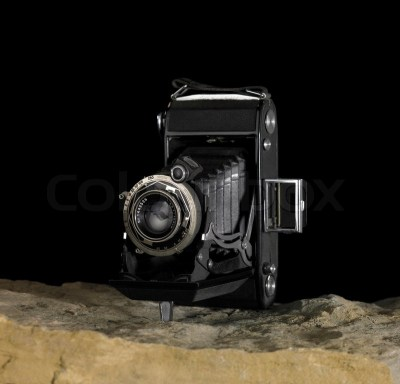 Still life with nostalgic camera on stone ground in front ...