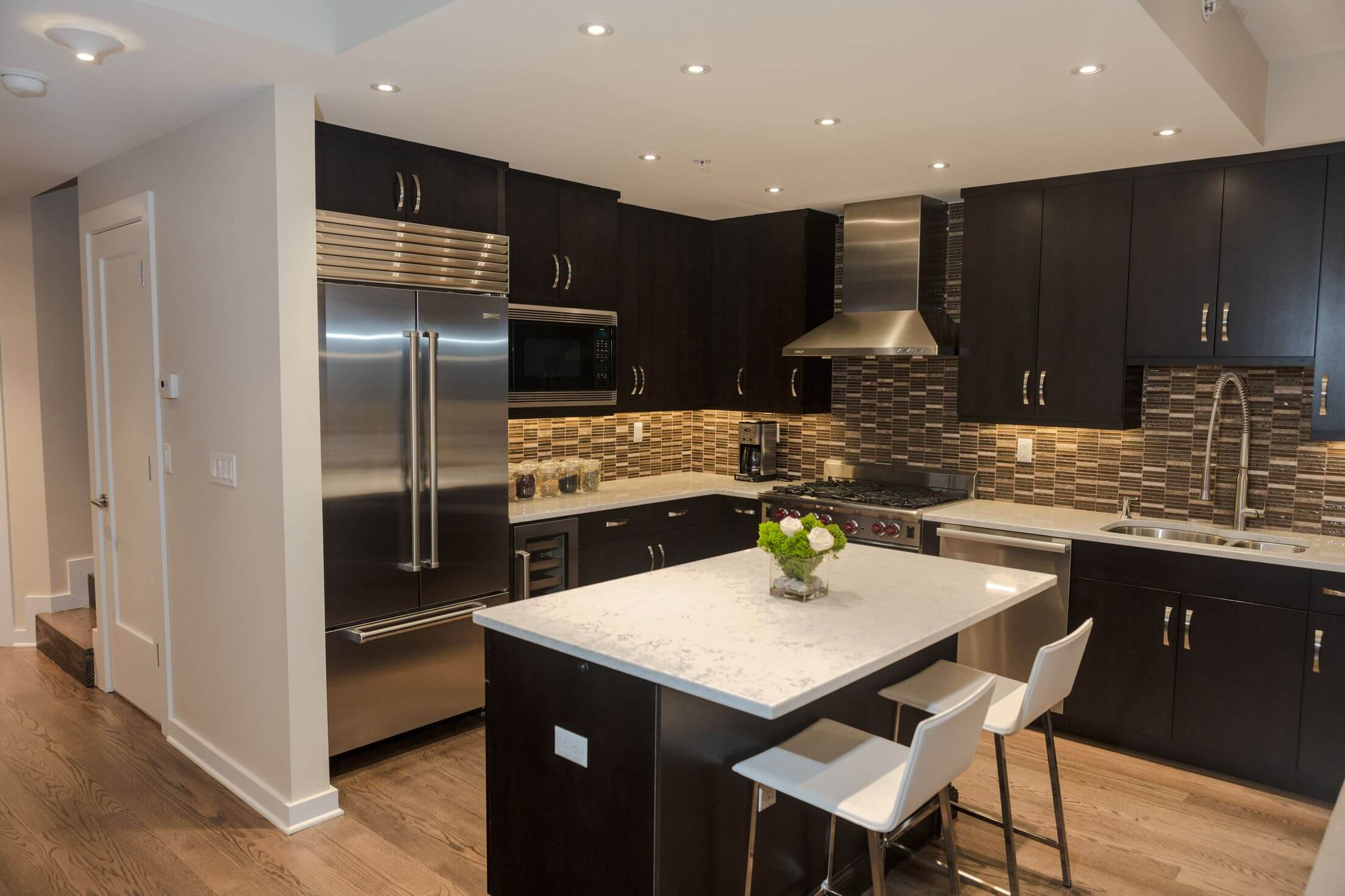 40 magnificent kitchen designs with dark cabinets kitchen counters and backsplash Black wood cabinetry and island contrast with patterned tile backsplash white marble countertops and