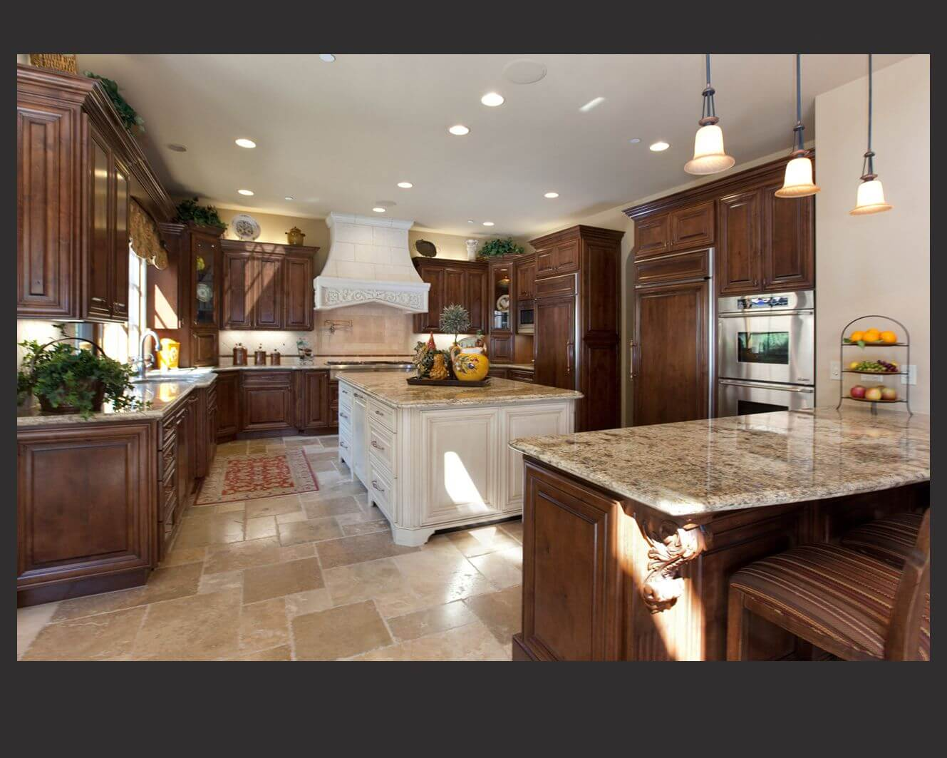 dark kitchen cabinets cabinets for kitchen island Richly detailed U shaped kitchen centers dark wood cabinetry around large white painted wood