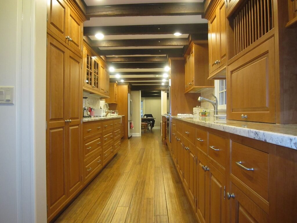 galley kitchen design ideas galley kitchen remodels Light wood toned galley kitchen with nearly matching floor
