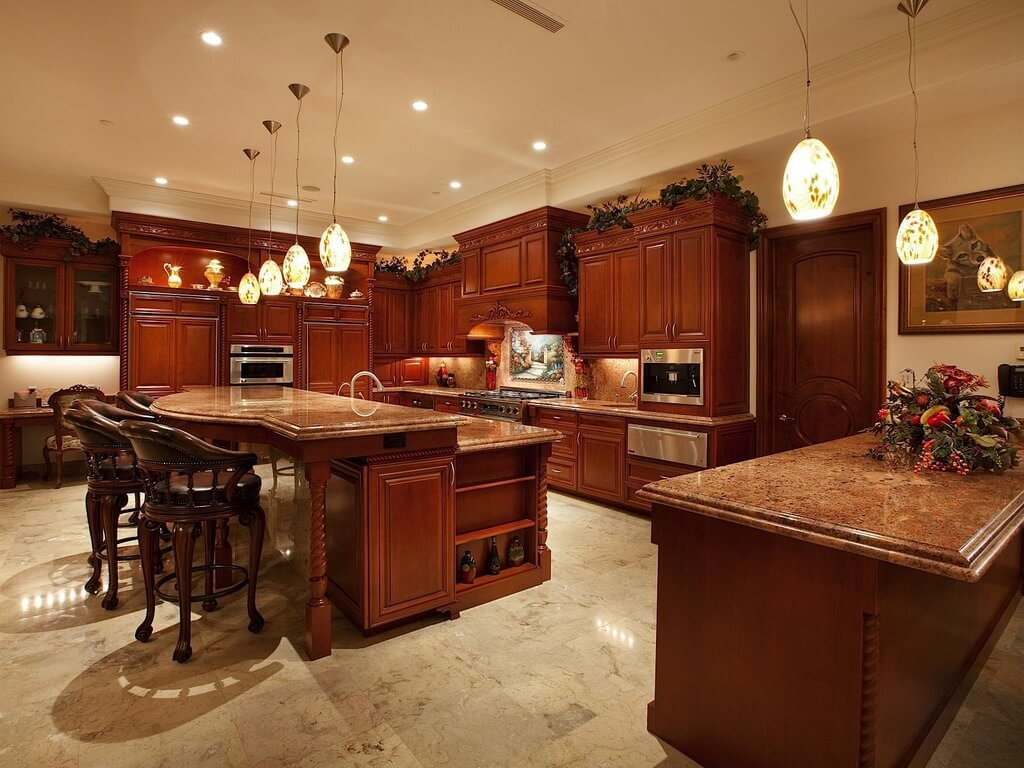 dark kitchen cabinets cherry wood cabinets kitchen Luxurious open kitchen with stained wood cabinetry and large two tier island at