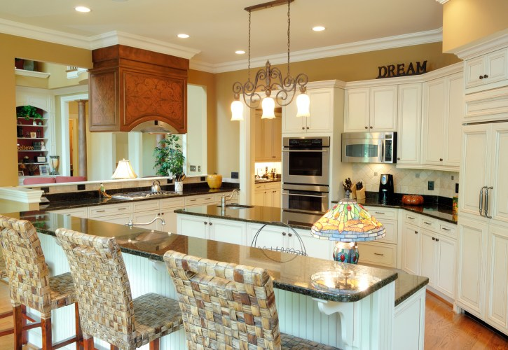 white kitchen designs pictures kitchen cabinets ideas Spacious country kitchen with white cabinetry throughout with mustard yellow walls