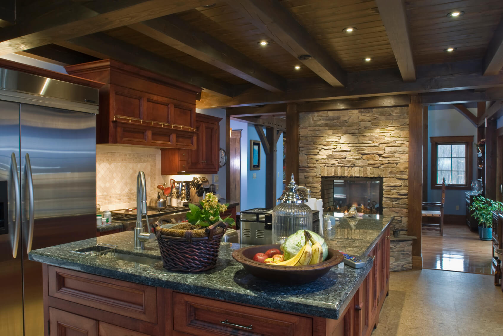dark kitchen cabinets cherry kitchen cabinets Rustic look kitchen features brick pass through fireplace under dark wood exposed beams with