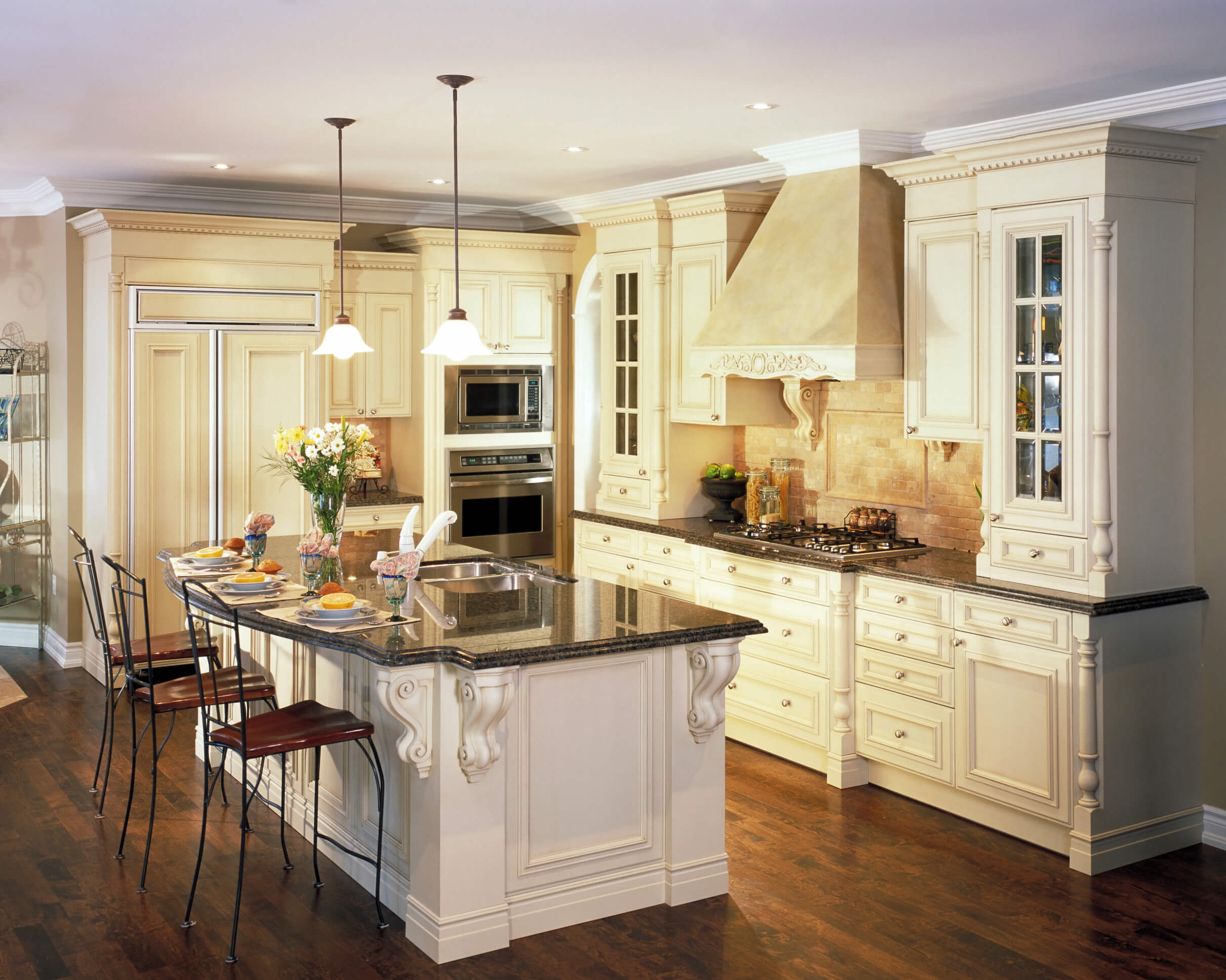dream kitchen designs white kitchen designs Kitchen featuring great contrast between dark wood flooring white cabinetry and black marble countertops