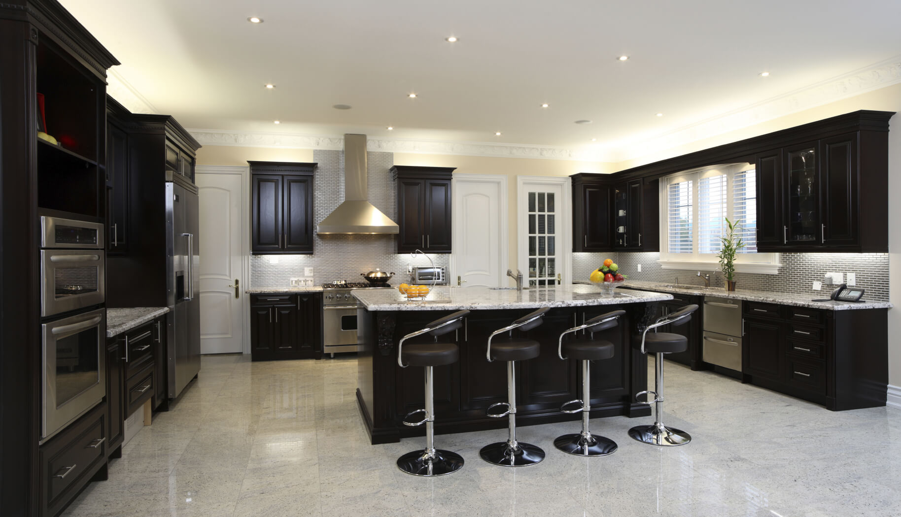 dark kitchen cabinets black kitchen cabinets Spacious modern kitchen with dark cabinetry breakfast bar 4 modern diner style stools and