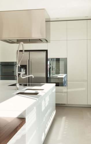 white kitchen designs pictures kitchen floor cabinets Ultra modern slick surfaces abound in this kitchen featuring glossy white cabinetry and countertops over