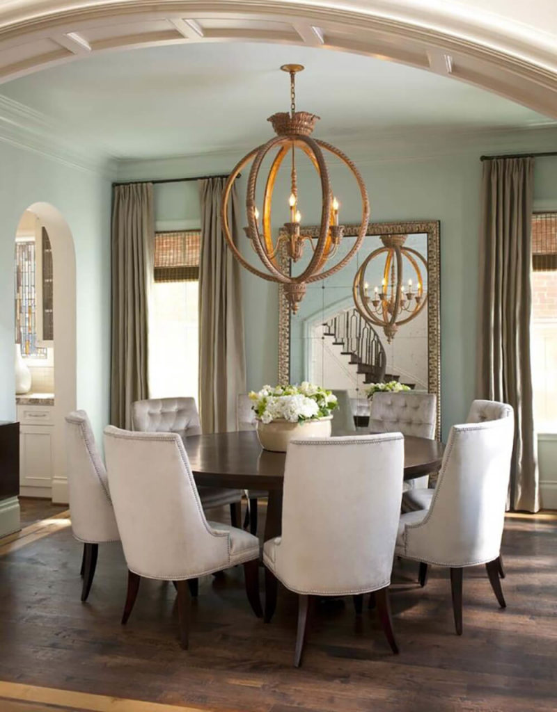 dining rooms with chandeliers kitchen table chandelier This glamorous dining room balances light walls with dark wood and features the astounding spherical chandelier suspended above the table