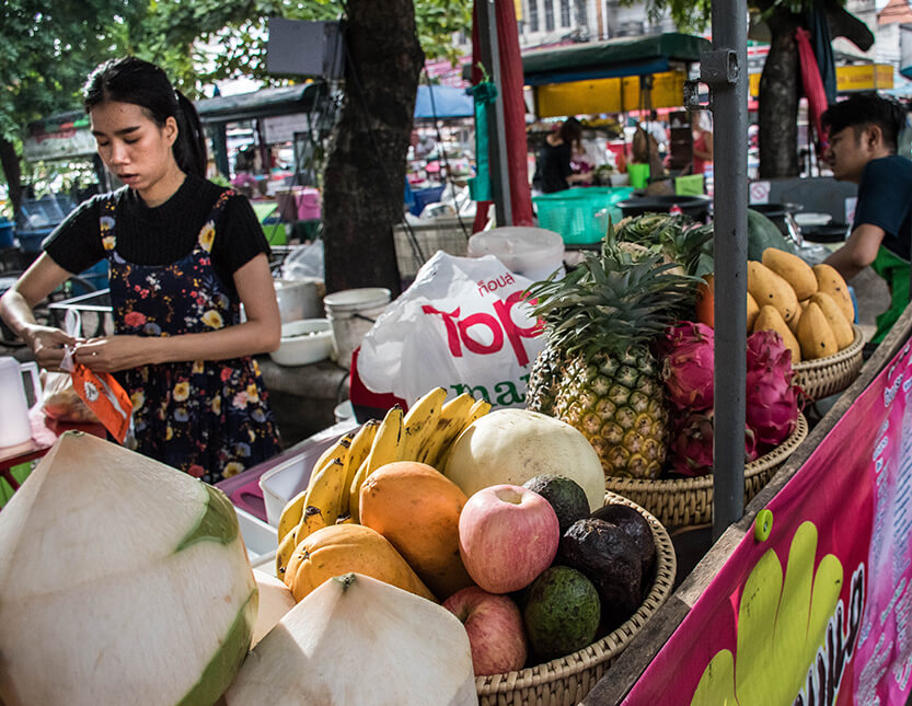 Woman making juices at food market – Chiang Mai