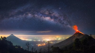 Milky Way Coming Out of an Erupting Volcano 4K wallpaper