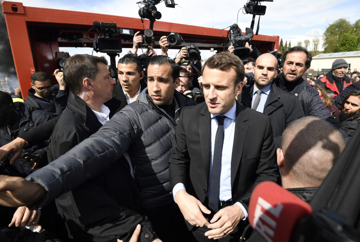Why France is freaking out over Macron s ex bodyguard     POLITICO Emmanuel Macron in Amiens in 2017  flanked by his bodyguard Alexandre  Benalla   Eric Feferberg AFP via Getty Images