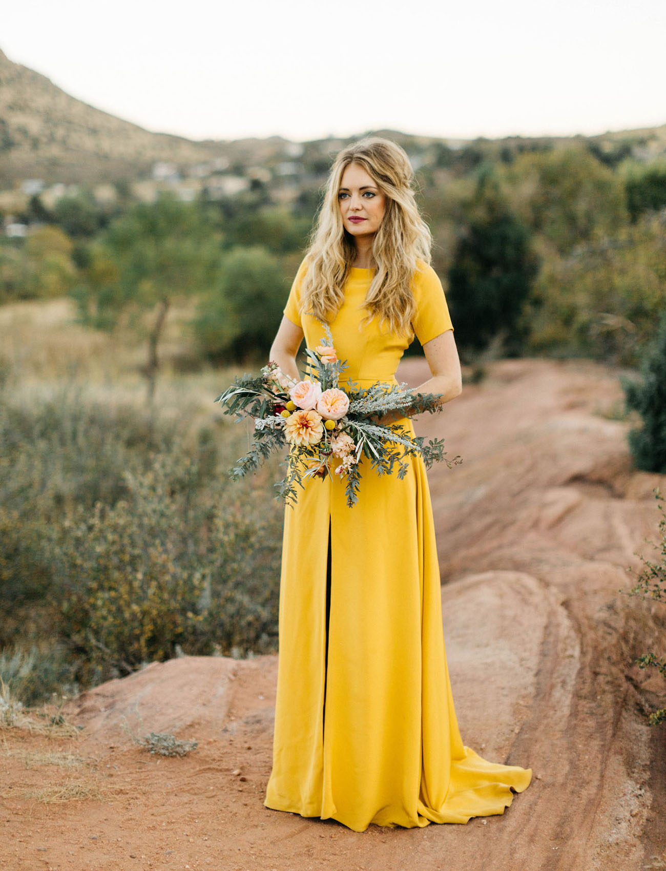 our favorite wedding dresses from green wedding dresses This Bold Sleek Mustard Yellow Wedding Dress