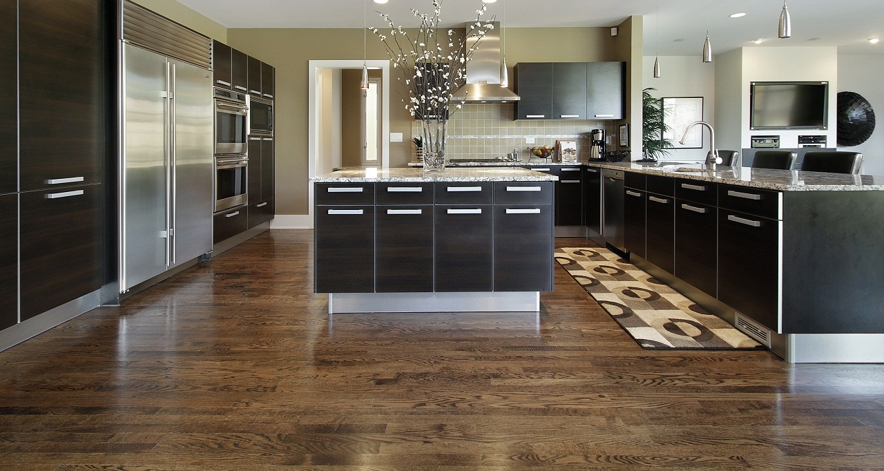 inspiring wooden flooring options for kitchens with modern cabinet system and pendant lights plus modern kitchen appliance