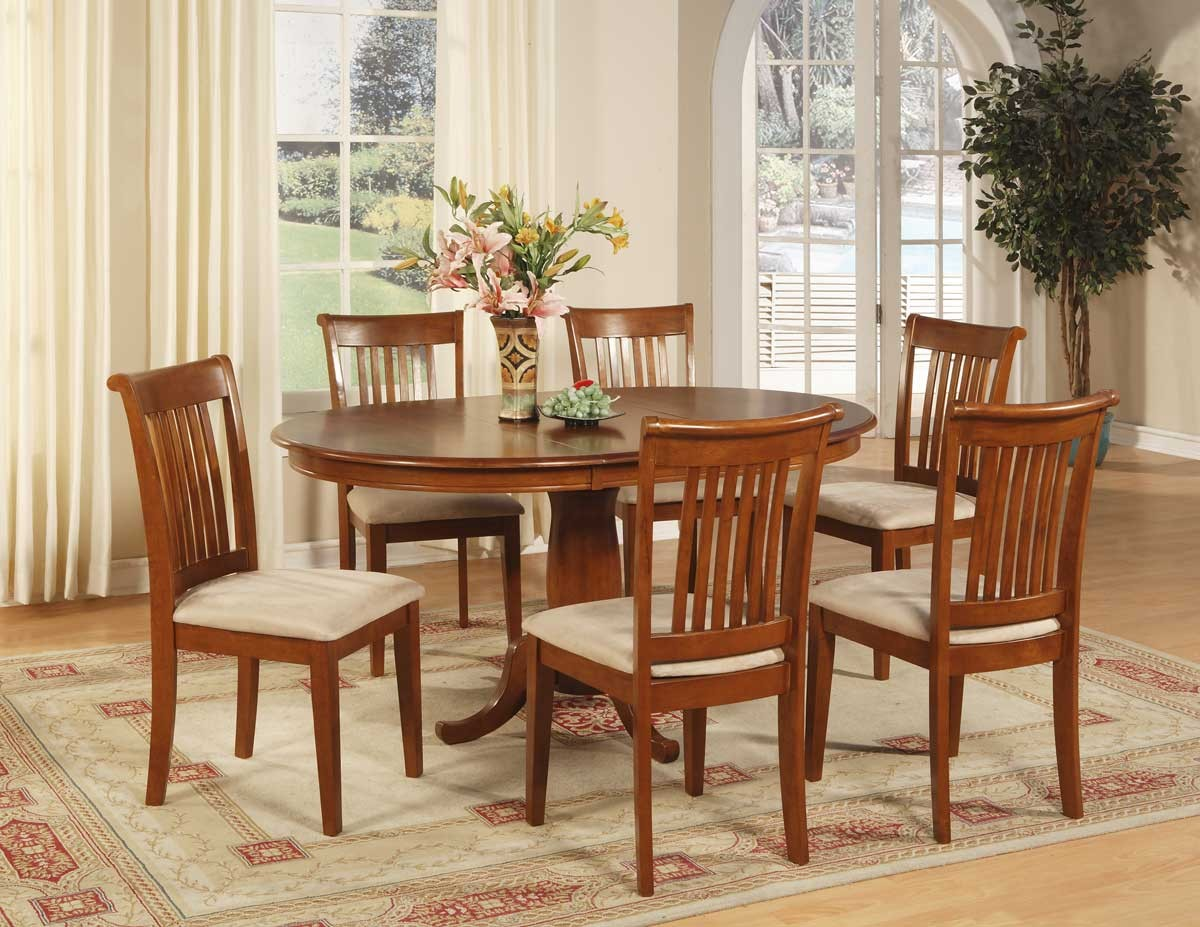classic wooden small oval dining table with wooden chairs beautiful decorative flower decorative livinf palnts beige red motive rug natural wooden floor ivory curtain