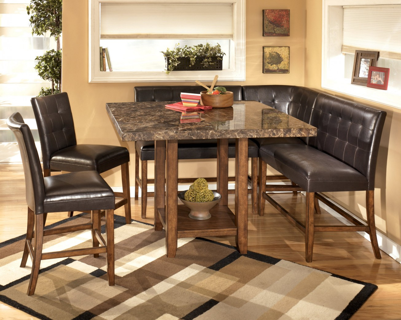 fascinating granite dining table set with rack underneath and sectional tufted leather chairs plus modern rug area on a wooden laminate floor