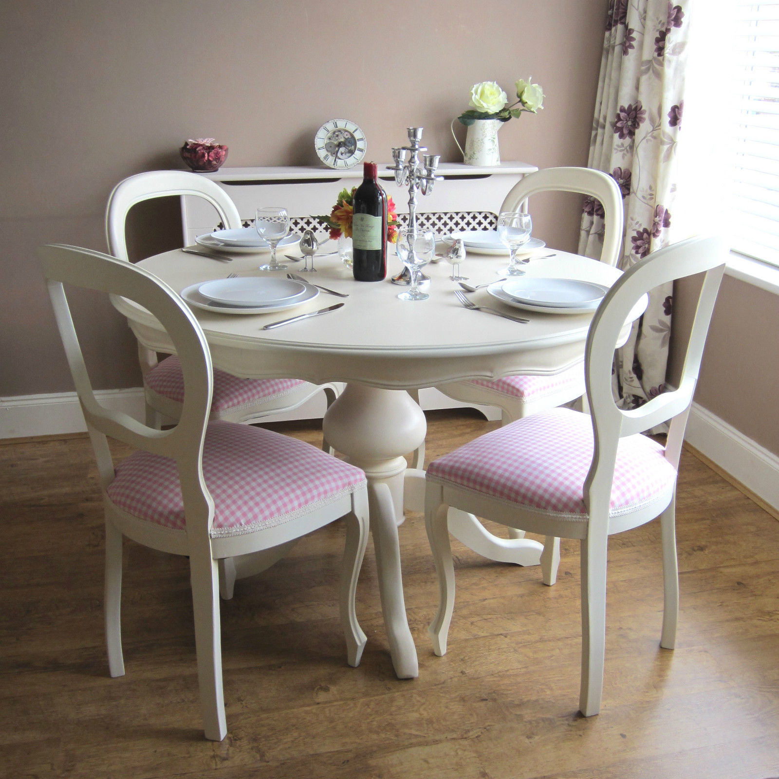 White Round Kitchen Table And Four Chairs With Cabinet And Flower Design Curtain