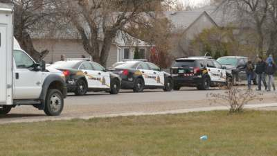 7 arrested after police raid Brandon home following months-long investigation | CBC News