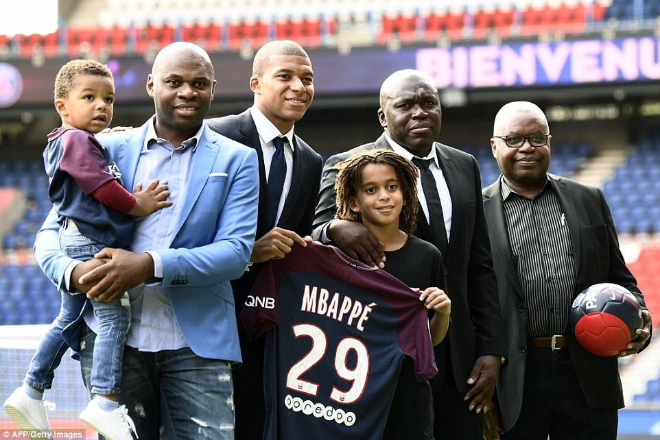 Kylian Mbappe opens up on decision to join PSG   Daily Mail Online Kylian Mbappe with dad Wilfried  second right   brother Ethan  third right