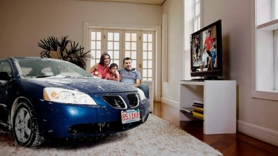 Family Lets Cars Come Inside House During Snowstorm