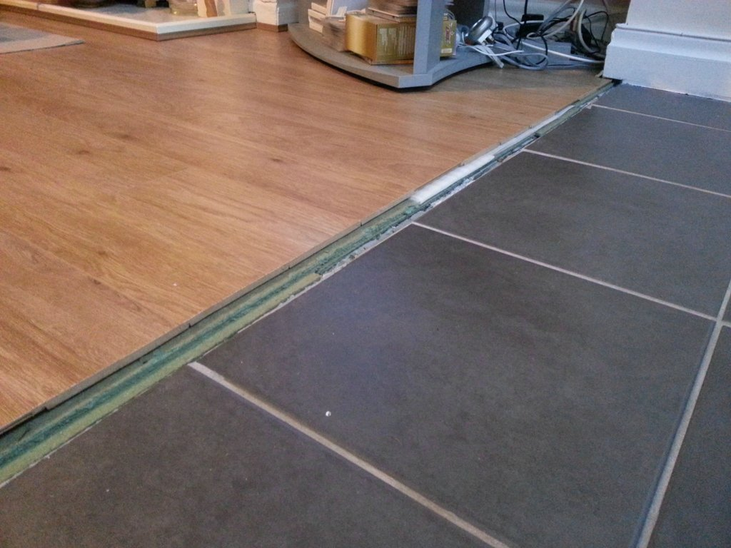 how can i transition between these floors laminate flooring for kitchen enter image description here