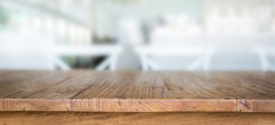 Wooden table with unfocused background Photo | Free Download