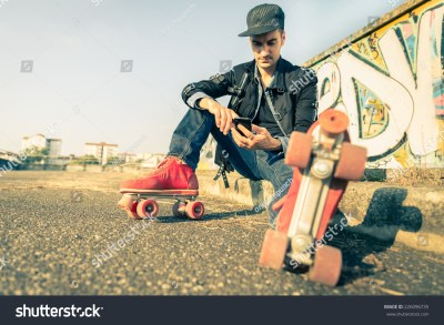 Cool Man With Roller Skating Shoe Using His Mobile Phone ...