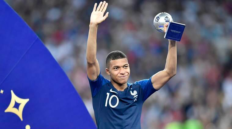 Kylian Mbappe reveals he was suffering with back injury during World     France s Kylian Mbappe poses with the best young player award after the  World Cup final against Croatia   Source  AP